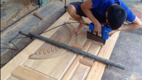 Young Man Building A Door