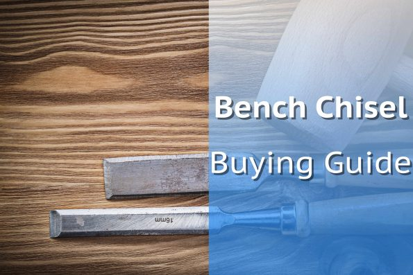 Pair Of Bench Chisels On Wooden Board